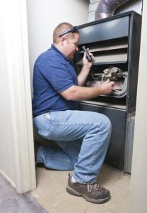 technician checking heater