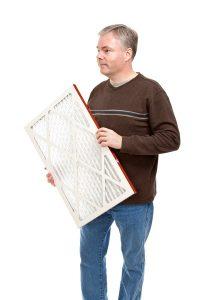man holding an air filter