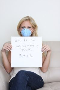 woman-holding-sign-about-healthy-air