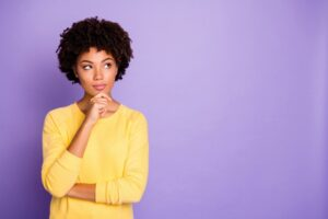 woman-looking-curious-on-purple-background