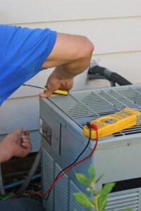 technician-hands-working-on-ac-outdoor-unit